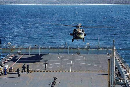 Black Hawk Helicopter landing on HMAS Choules